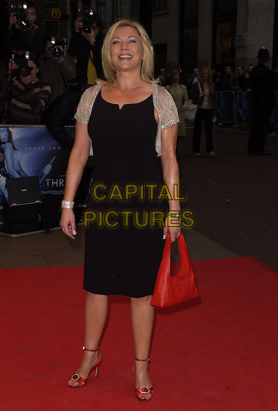 """AMANDA REDMAN.World Premiere of """"Three"""" at the Odeon West End, Leicester Square, London, UK..May 2nd, 2006.Ref: CAN.full length red purse balck dress shoes.www.capitalpictures.com.sales@capitalpictures.com.©Capital Pictures"""