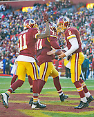 Washington Redskins wide receiver DeSean Jackson (11) and Washington Redskins quarterback Kirk Cousins (8) celebrate a second quarter touchdown against the Buffalo Bills at FedEx Field in Landover, Maryland on Sunday, December 20, 2015.<br /> Credit: Ron Sachs / CNP