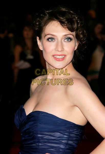 "CARICE VAN HOUTEN.At the UK Film Premiere of ""Valkyrie"", Odeon Leicester Square, London, England, January 21st 2009..portrait headshot false eyelashes hair up strapless ink blue chiffon dress .CAP/AH.©Adam Houghton/Capital Pictures"