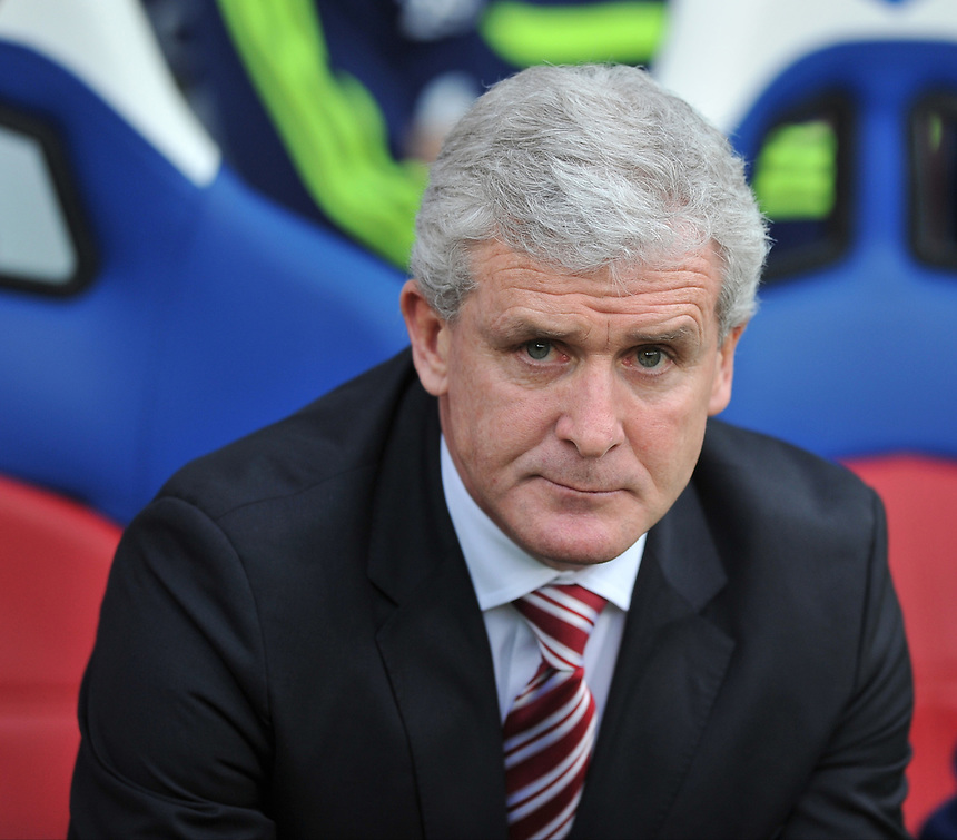Stoke City's Manager Mark Hughes <br /> <br /> Photo by Ashley Western/CameraSport<br /> <br /> Football - Barclays Premiership - Crystal Palace v Stoke City - Saturday 18th January 2014 - Selhurst Park - London<br /> <br /> &copy; CameraSport - 43 Linden Ave. Countesthorpe. Leicester. England. LE8 5PG - Tel: +44 (0) 116 277 4147 - admin@camerasport.com - www.camerasport.com