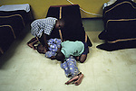 KLIPRIVER, SOUTH AFRICA APRIL 14: Young boys play as they are about to fall asleep around 8PM on April 14, 2003 after taking a shower at Sibonile (means: we have seen) School for the Blind in Klipriver, south of Johannesburg, South Africa. A blind woman founded the school in 1994. The school has about 125 students from disadvantaged communities around South Africa. Many of the children have faced rejection from their families and communities, and at Sibonile they have a chance for a good education. .(Photo: Per-Anders Pettersson).