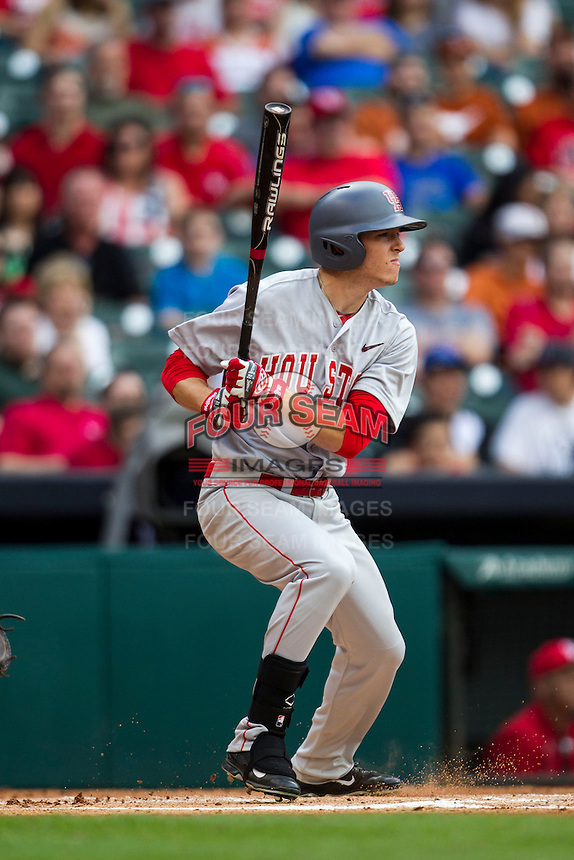 Houston Cougars outfielder Kyle Survance #34 follows through on his swing during the NCAA baseball game against the Texas Longhorns on March 1, 2014 during the Houston College Classic at Minute Maid Park in Houston, Texas. The Longhorns defeated the Cougars 3-2. (Andrew Woolley/Four Seam Images)