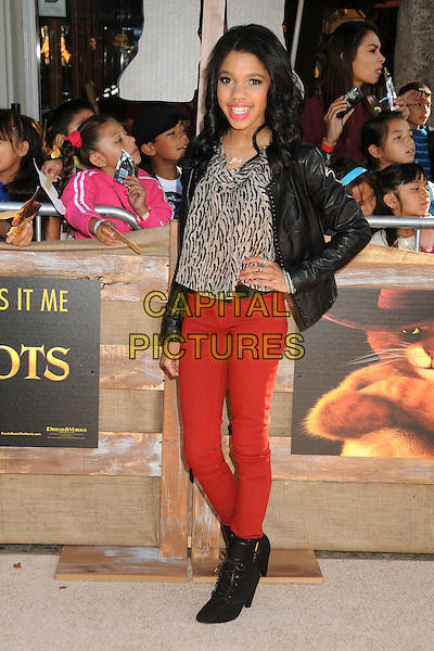 Teala Dunn.The L.A. Premiere of 'Puss in Boots' held at The Regency Village Theatre in Westwood, California, USA..October 23rd, 2011.full length beige print top jeans denim jacket hand on hip.CAP/ADM/BP.©Byron Purvis/AdMedia/Capital Pictures.