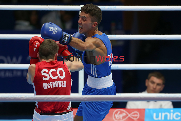 Glasgow 2014 Commonwealth Games<br /> Men's Fly (52kg) preliminary bout. <br /> Welsh boxer Andrew Selby (Blue) in action against Scotland's Reece McFadden (Red)<br /> 25.07.14<br /> &copy;Steve Pope-SPORTINGWALES