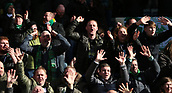 17th March 2019, Dens Park, Dundee, Scotland; Ladbrokes Premiership football, Dundee versus Celtic; Celtic supporters celebrate the win