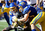 BROOKINGS, SD - NOVEMBER 5:  Eric Kleinschmit #31 and Thomas Hopp 33 from South Dakota State brings down Dion Holliman #5 form Missouri State in the first half Saturday afternoon at Dana J. Dykhouse Stadium in Brookings. (Photo by Dave Eggen/Inertia)
