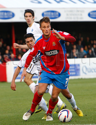 27.10.2012 Dagenham, England: ..Sam Williams of Dagenham & Redbridge and Danny Rose of Aldershot Town (on loan from Fleetwood Town)..in action during the League Two match between Dagenham and Redbridge & Aldershot Town from The L.B Barking & Dag Stadium, Victoria Road..