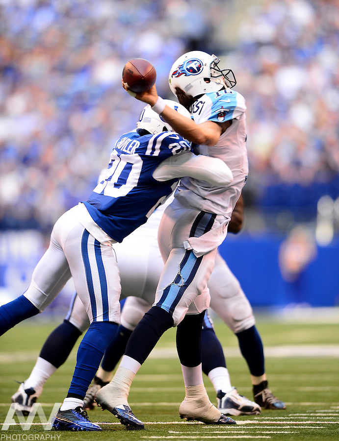 Sep 28, 2014; Indianapolis, IN, USA; Tennessee Titans quarterback Charlie Whitehurst (12) is sacked by Indianapolis Colts free safety Darius Butler (20) during the third quarter at Lucas Oil Stadium. Colts defeated the Titans 41-17. Mandatory Credit: Andrew Weber-USA TODAY Sports