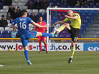 Greg Tansey and Jim Goodwin go toe to toe in the Inverness Caledonian Thistle v St Mirren Scottish Professional Football League Premiership match played at the Tulloch Caledonian Stadium, Inverness on 29.3.14.