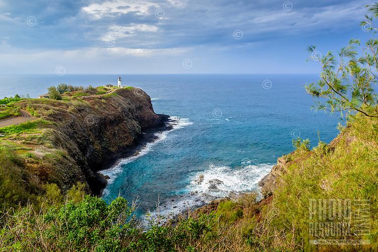 Kilauea Lighthouse on a headland overlooking the blue Pacific Ocean, Kaua'i.