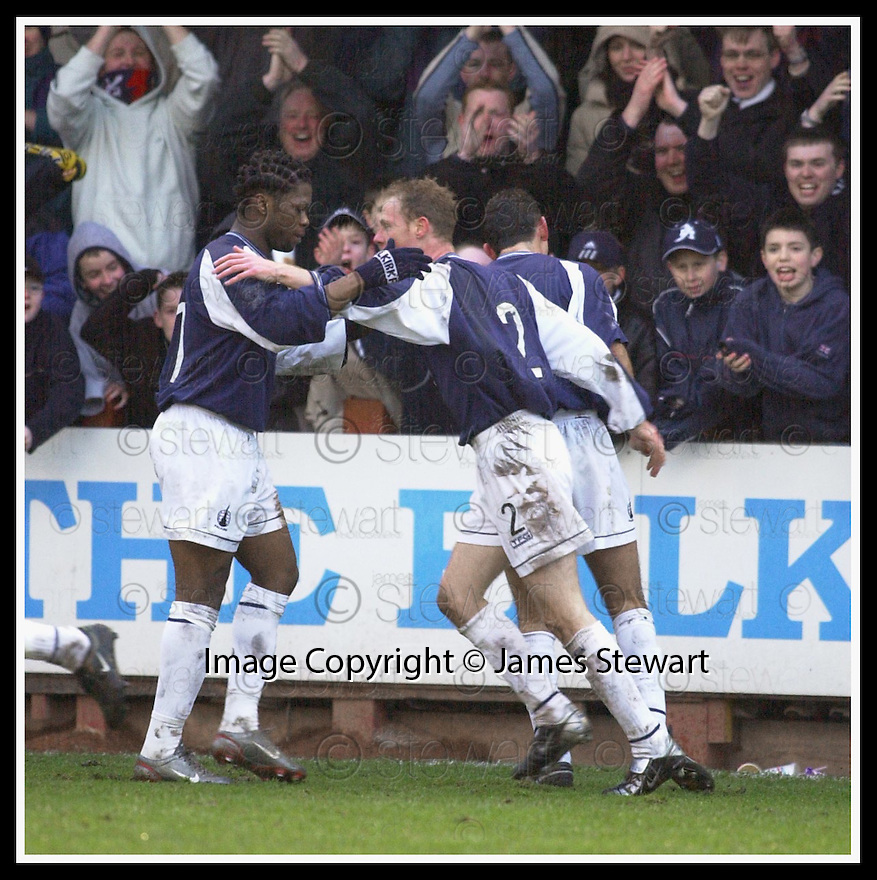01/02/2003                   Copyright Pic : James Stewart.File Name : stewart-falkirk v st john 16.COLLIN SAMUEL CONGRATULATES JOHN HENRY AFTER HE SCORED FALKIRK'S EQUALISER.....James Stewart Photo Agency, 19 Carronlea Drive, Falkirk. FK2 8DN      Vat Reg No. 607 6932 25.Office     : +44 (0)1324 570906     .Mobile  : +44 (0)7721 416997.Fax         :  +44 (0)1324 570906.E-mail  :  jim@jspa.co.uk.If you require further information then contact Jim Stewart on any of the numbers above.........