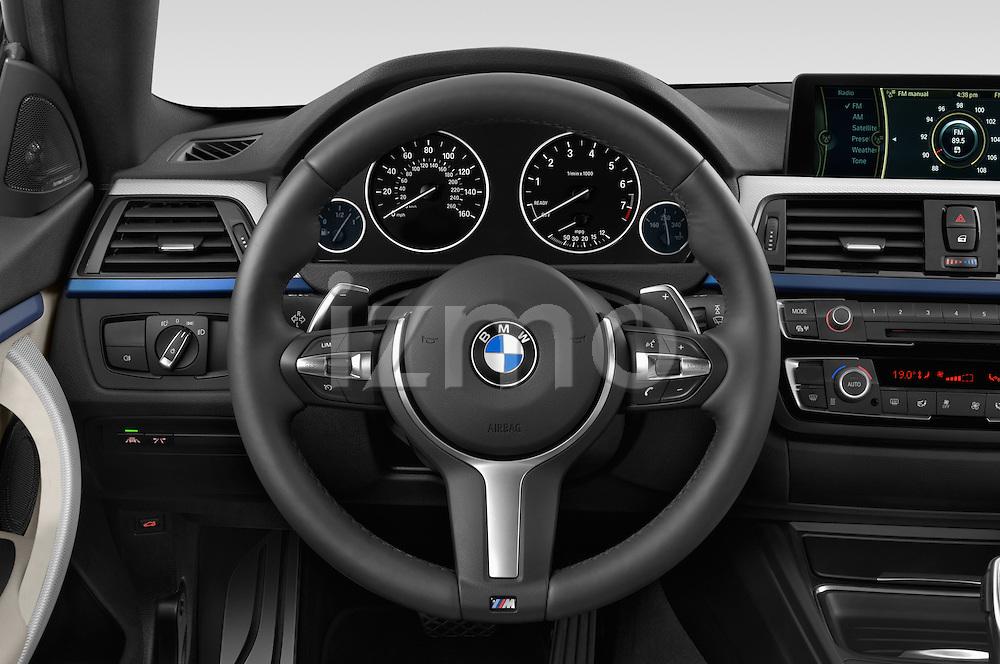 Car pictures of steering wheel view of a 2015 BMW 4 Series 435i Gran Coupe 5 Door Hatchback Steering Wheel