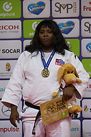 Gold medalist Idalys Ortiz of Cuba celebrates her victory during an awards ceremony after the Women +78 kg category at the Judo Grand Prix Budapest 2018 international judo tournament held in Budapest, Hungary on Aug. 12, 2018. ATTILA VOLGYI