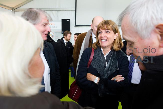 Anne Lauvergeon visite la chaufferie biomasse de Stains en Seine-Saint-Denis, près de Paris, France, le 30 mars 2013. Photo : Lucas Schifres