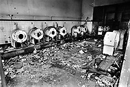 Brooklyn, New York, NY.  August, 1971. An abandoned laundromat in Bed-Stuy.