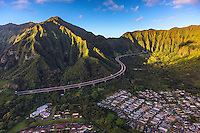 The view during a helicopter tour of the H-3 Highway (or John A. Burns Freeway) along and through the Ko'olau Mountains, with Kane'ohe on the right, Windward O'ahu.