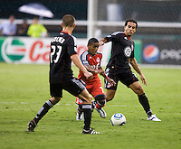 Dwayne De Rosario (7) and Perry Kitchen (23) of D.C. United try to take the ball away from Joao Plata (7) of Toronto FC during the game at RFK Stadium in Washington, DC.  D.C. United tied Toronto FC, 3-3.