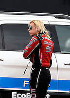 Apr 26, 2014; Baytown, TX, USA; NHRA funny car driver Courtney Force during qualifying for the Spring Nationals at Royal Purple Raceway. Mandatory Credit: Mark J. Rebilas-
