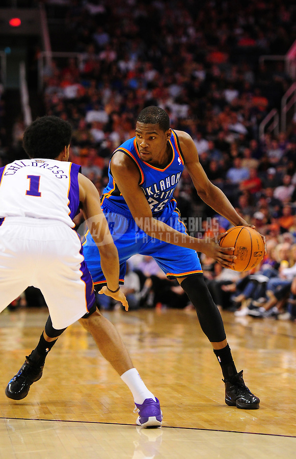 Mar. 30, 2011; Phoenix, AZ, USA; Oklahoma City Thunder forward (35) Kevin Durant against the Phoenix Suns at the US Airways Center. Mandatory Credit: Mark J. Rebilas-