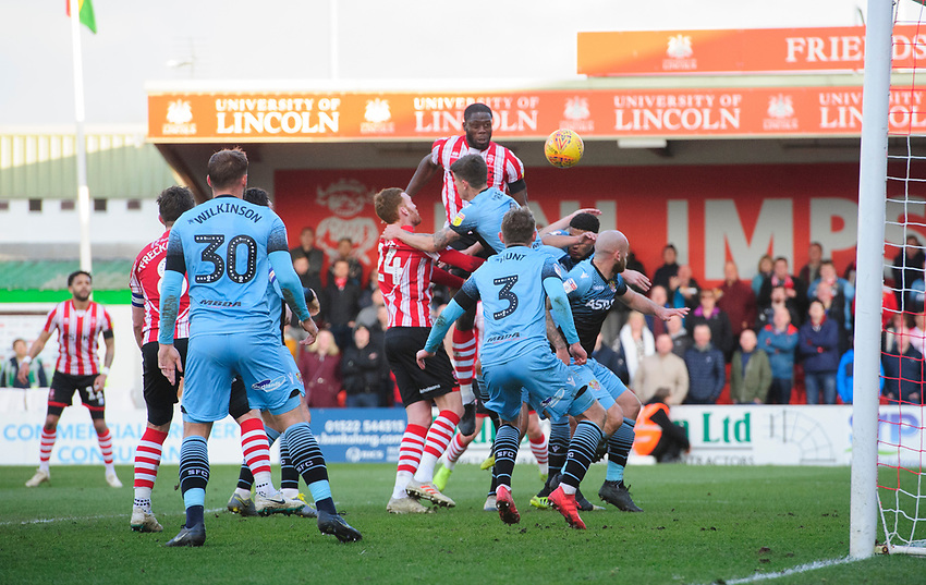 Lincoln City's John Akinde has a header cleared off the line by Stevenage's Johnny Hunt<br /> <br /> Photographer Chris Vaughan/CameraSport<br /> <br /> The EFL Sky Bet League Two - Lincoln City v Stevenage - Saturday 16th February 2019 - Sincil Bank - Lincoln<br /> <br /> World Copyright © 2019 CameraSport. All rights reserved. 43 Linden Ave. Countesthorpe. Leicester. England. LE8 5PG - Tel: +44 (0) 116 277 4147 - admin@camerasport.com - www.camerasport.com