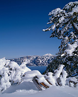 67ORCL_05 - USA, Oregon, Crater Lake National Park, Winter snow accumulates at Crater Lake and on distant Mount Scott.