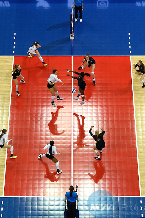 COLUMBUS, OH - DECEMBER 17:  Yaazie Bedart-Ghani (27) of the University of Texas hits a kill past Inky Ajanaku (12) of Stanford University during the Division I Women's Volleyball Championship held at Nationwide Arena on December 17, 2016 in Columbus, Ohio.  Stanford beat Texas 3-1 to win the national title. (Photo by Jamie Schwaberow/NCAA Photos via Getty Images)