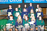 POSTERS: The 14-17 year old category students who took part in the Clanmaurice Credit Union Poster competition who received their prizes at Causeway Comprehensive School on Thursday pictured Denise Crickard, Sarah Casey, Niamh Carlin, Chris Barrett, Niamh Tynam, Joseph Hickey, Molly O'Regan, Elizabeth Hussey, Melissa Kiely, Brogan O'Grady, Michelle Gilbert, Romany Mahony, Sean O'Sullivan and Ma?ire Barrett.