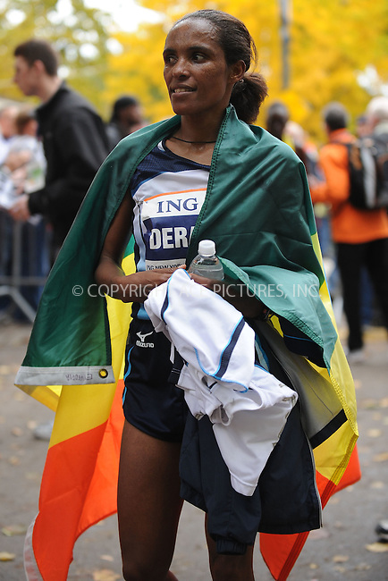 WWW.ACEPIXS.COM . . . . . ....November 1 2009, New York City....Derartu Tulu of Ethiopia (c) celebrates after her win in the 40th women's ING New York City Marathon on November 1, 2009 in New York City.....Please byline: KRISTIN CALLAHAN - ACEPIXS.COM.. . . . . . ..Ace Pictures, Inc:  ..(212) 243-8787 or (646) 679 0430..e-mail: picturedesk@acepixs.com..web: http://www.acepixs.com