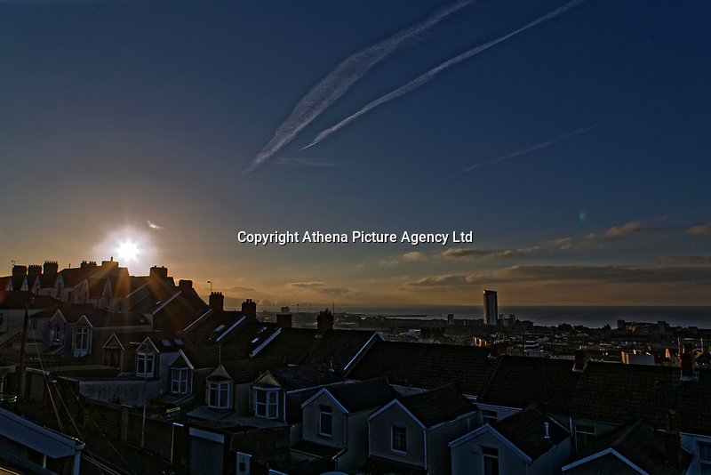 The sun rises over a row of terraced houses' rooftops in the Mount Pleasant area of Swansea, in south Wales, UK marking the Spring Equinox when the length of the day is equal to the length of the night. Tuesday 20 March 2018