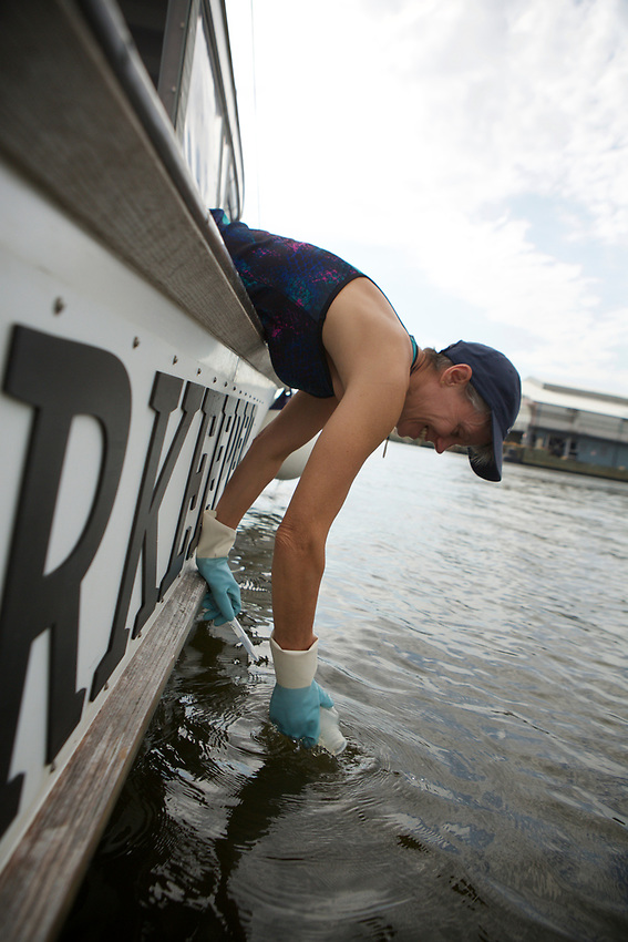 Queens, NY - July 10, 2017:  In her work for Riverkeepers, Columbia University researcher Carol Knudson takes samples water in Newtown Creek and tests it for particulates to determine the degree of pollution.<br />