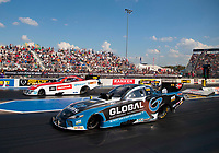 Sep 29, 2019; Madison, IL, USA; NHRA funny car driver Shawn Langdon (near) races alongside Bob Tasca III during the Midwest Nationals at World Wide Technology Raceway. Mandatory Credit: Mark J. Rebilas-USA TODAY Sports