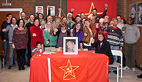 Comrades attending a CPGBML Saklatvala Hall Commemoration celebrating the centenary of Kim Il-sung's birth, behind a portrait of our late comrade Godfrey Cremer, Easter Sunday 2012 Southall