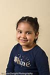 closeup headshot portrait of girl age 4 or 5 vertical