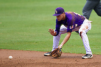 LSU Tigers second baseman Jacoby Jones #23 fields a grounder during the NCAA Super Regional baseball game against Stony Brook on June 9, 2012 at Alex Box Stadium in Baton Rouge, Louisiana. Stony Brook defeated LSU 3-1. (Andrew Woolley/Four Seam Images)