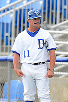 Dunedin Blue Jays hitting coach Stubby Clapp (11) sporting a fake mustache during a game against the Fort Myers Miracle on July 20, 2013 at Florida Auto Exchange Stadium in Dunedin, Florida.  Fort Myers defeated Dunedin 3-1.  (Mike Janes/Four Seam Images)