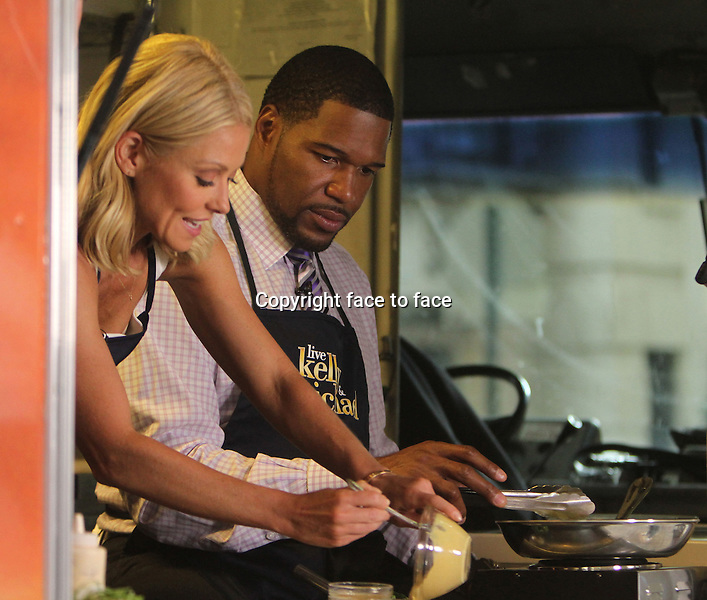 Michael Strahan and Kelly Ripa at Live with Kelly &amp; Michael for Live's Truckin' Amazing Cook-Off in New York, 03.07.2013.<br /> Credit: MediaPunch/face to face<br /> - Germany, Austria, Switzerland, Eastern Europe, Australia, UK, USA, Taiwan, Singapore, China, Malaysia, Thailand, Sweden, Estonia, Latvia and Lithuania rights only -