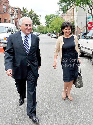 Dominique Strauss-Kahn, the former head of the International Monetary Fund (IMF), and his wife, Anne Sinclair, return to their Georgetown home after visiting IMF headquarters in Washington, D.C. on Monday, August 29, 2011..Credit: Ron Sachs / CNP.(RESTRICTION: NO New York or New Jersey Newspapers or newspapers within a 75 mile radius of New York City).