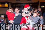 Jessica Sheehy, Linda Donoghue and Amelia Donoghue Listowel met Minnie Mouse at the Killarney New Years eve concert on Main street
