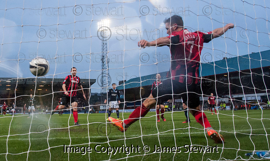 St Johnstone's Chris Millar can't stop Dundee's David Clarkson shot from hitting the back of the net.