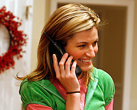 "ESPN reporter Erin Andrews at home in Dunwoody, Ga. on Thursday, Dec. 14, 2006. She says she'll often stay up until 2 a.m. reading team guides and surfing the Internet to help her prepare to report a game. Andrews will be a contestant on the television show ""Dancing With the Stars."""