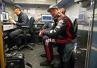 Jun 7, 2015; Englishtown, NJ, USA; NHRA top fuel driver Morgan Lucas (right) in his teams hauler with crew chief Aaron Brooks during the Summernationals at Old Bridge Township Raceway Park. Mandatory Credit: Mark J. Rebilas-