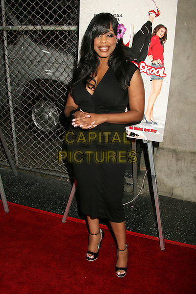 "NIECY NASH .""Kickin' It Old Skool"" Los Angeles Premiere Party at the Music Box Theatre, Hollywood, California, USA..April 25th, 2007.full length black dress purple flower in hair .CAP/ADM/BP.©Byron Purvis/AdMedia/Capital Pictures"