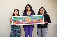 From left, Jacqueline Ayala '14, Highland Park artist Pola Lopez and Bianca Fonseca Cervantes '14 show a small scale maquette of the finished Educational Empowerment Mural before installation in the Academic Commons on May 6, 2014. (Photo by Marc Campos, Occidental College Photographer)