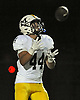 Massapequa No. 44 Sal Americo fields a kickoff during a Nassau County Conference I varsity football game against host Freeport High School on Friday, September 25, 2015<br /> <br /> James Escher