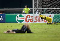 Bill Hamid (28) of D.C. United pounds the ground in frustration as teammate Blake Brettschneider (29) lies exhausted after the game at RFK Stadium in Washington, D.C. D.C. United tied the Portland Timbers, 1-1.