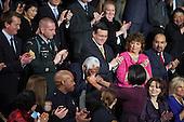 Raymond Joseph, Haiti's Ambassador to the United States, kisses the hand of First Lady Michelle Obama at the U.S. Capitol during U.S. President Barack Obama's State of the Union address, Wednesday, January 27, 2010..Mandatory Credit: Samantha Appleton - White House via CNP