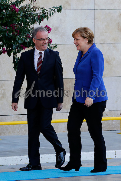 15 November 2015 - Berlin, Germany - Turkish President welcomes the German Chancellor Angela Merkel at the hotel Regnum in Belek on November 15, 2015. The turkish Chief of Protokoll shows the way.<br /> Photo Credit: Stocki/face to face/AdMedia