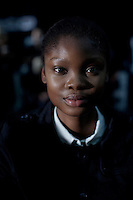 CAPE TOWN, SOUTH AFRICA AUGUST 9: Favour Lucky, a 15-year old Nigerian model, waits backstage before a fashion show on August 9, 2013 in Cape Town, South Africa. She won Nigeria's next supermodel and has worked at fashion weeks in Johannesburg, Cape Town, New York and others. She walked in several shows at Mercedes Benz Cape Town Fashion Week where some of South Africa's finest designers showed their 2012-13 spring and summer collections during the 4-day event (Photo by: Per-Anders Pettersson)