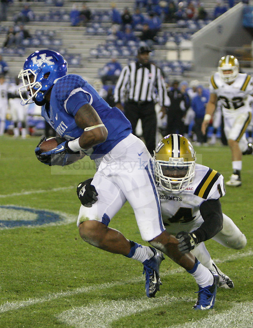 Alabama State linebacker Daerius Washington (14) tackles UK wide receiver A.J. Legree (6) at the University of Kentucky Homecoming football game against Alabama State at Commonwealth Stadium in Lexington, Ky., on Saturday, November 2, 2013. Photo by Emily Wuetcher | Staff