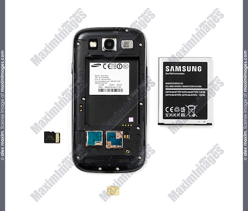 Samsung Android phone without the rear cover and removed battery, memory and SIM card isolated on white background